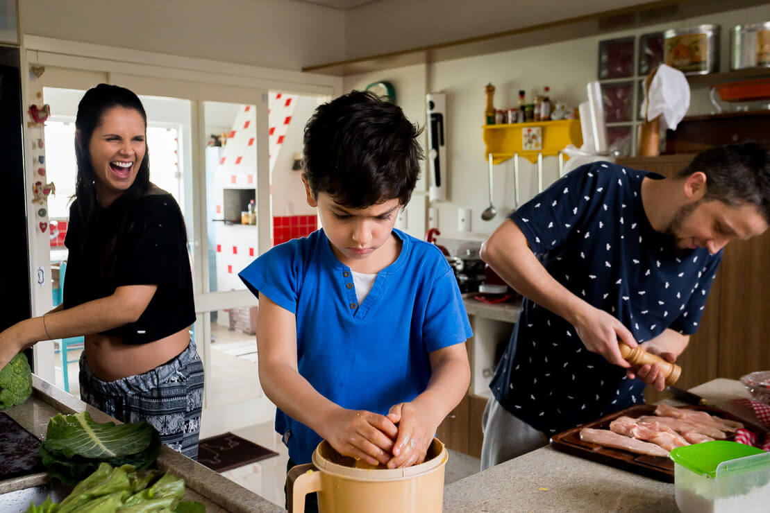 Family cooking together during