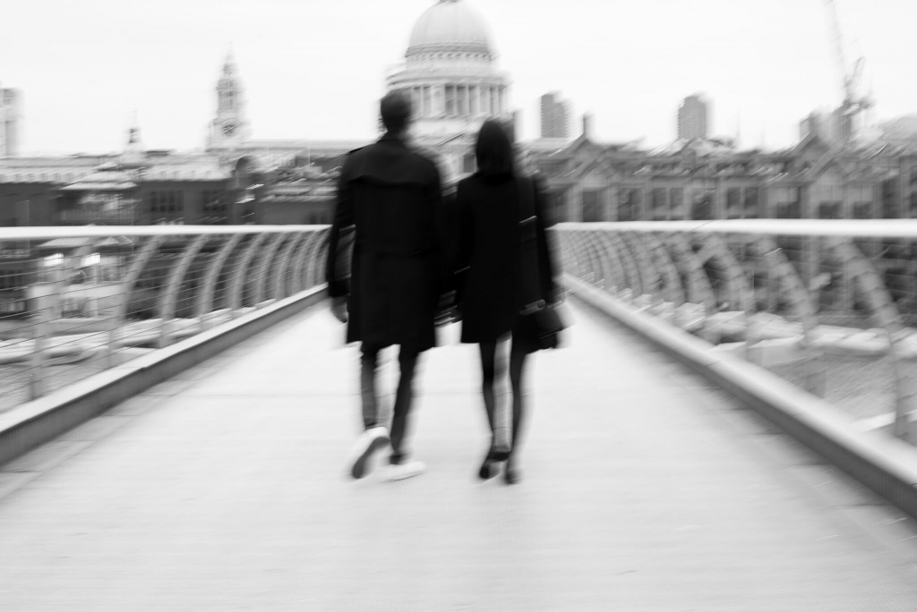 Blur couple walking on the Millenium Bridge