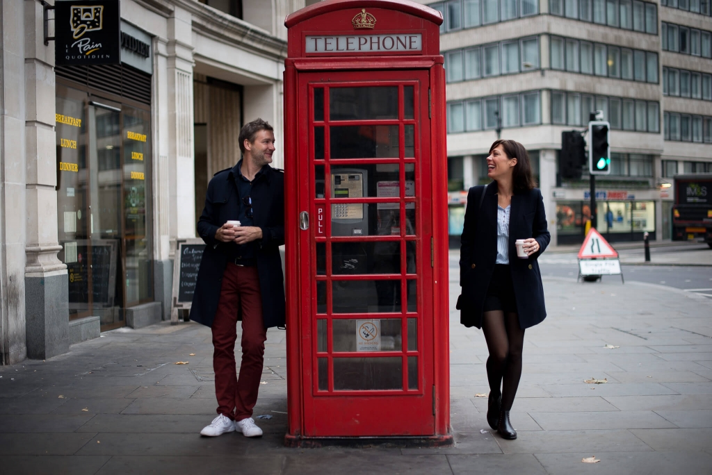 Couple and a telephone boot in London
